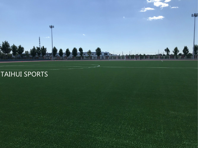 Football field of FIFA Quality Pro including shock pad and TPE infill granule