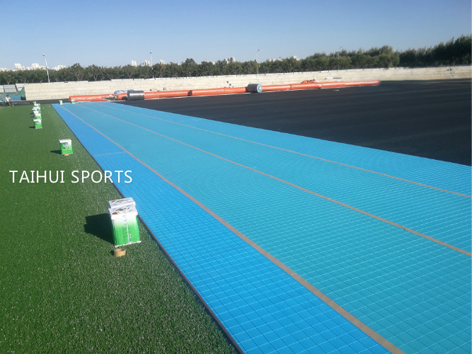 University football field with performance Shock pad underlay installed on site